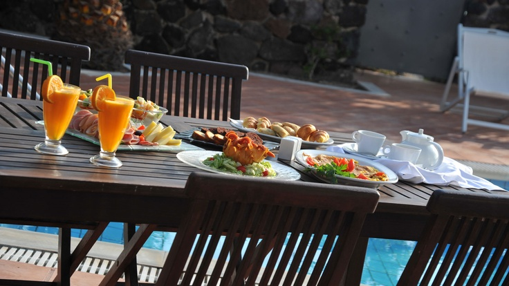 Breakfast at the private pool Villa Zeus