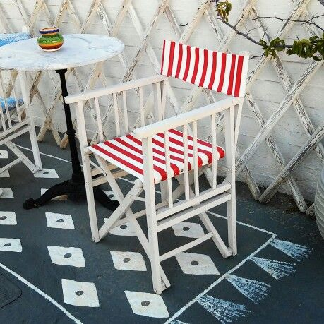 """Painted the boring concrete floor, outside of my store, with a kilim style """"carpet""""!! Love the look!"""