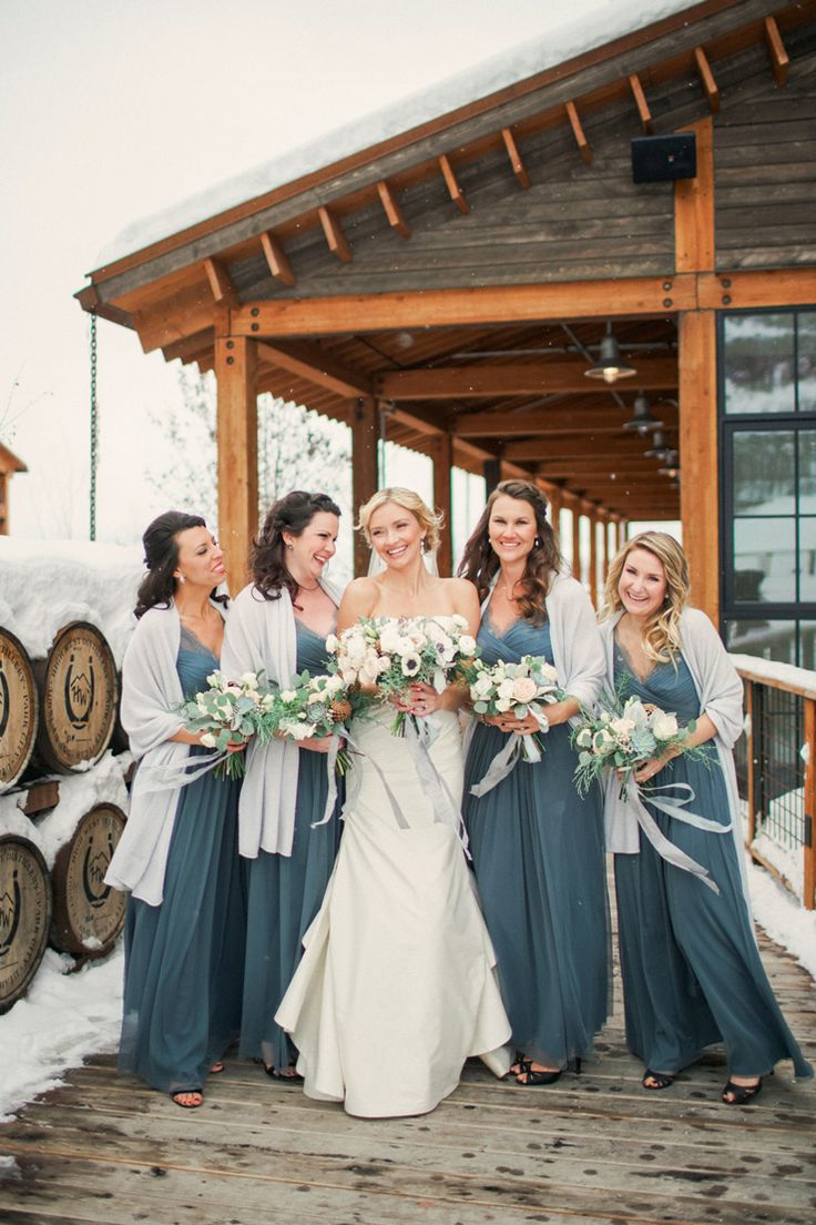 winter bridesmaid dresses winter wedding dresses A strapless wedding gown for a winter wedding at Blue Sky Ranch Blue and gold colour palette