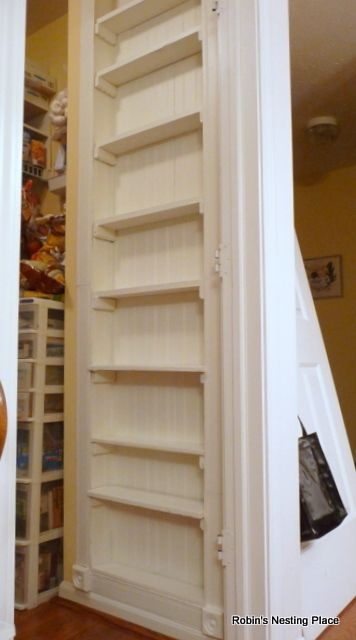 The recessed shelves, built between studs on a pantry wall, gives plenty