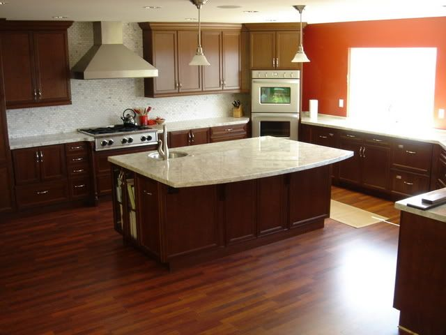 dark laminate flooring in kitchen cabinets light countertops light tile backsplash 8564