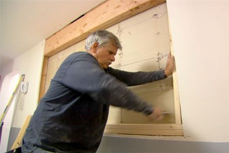 This Old House general contractor Tom Silva shows you how to cut a pass through in a wall to make a small kitchen feel larger
