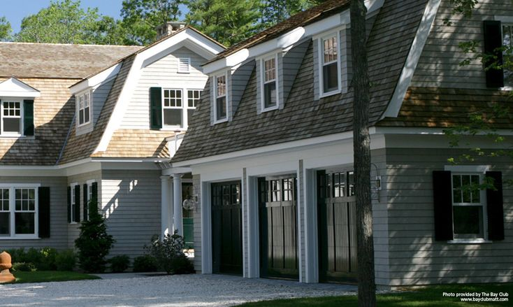 """This large-scale residential project is using high-quality genuine wood shingle as main emphasis, which contributes to its integration with the surrounding nature. The """"Maibec Seacoast""""-coloured shingle, which covers the whole facing, adds a touch of authenticity and purity to the country house. The """"Georgian Colonial White"""" original hue is worn by the property's two-inch moulding."""