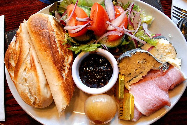 Ploughmans platter - consists usually of fresh bread, Branston pickle, cheese, ham, small salad and pickled onion! This together with a pint of your preference = perfect lunch!!