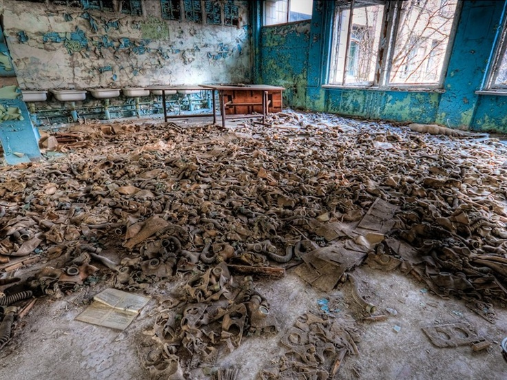 On a tour of Chernobyl, Timm Suess found a school where, in this classroom is a tragic pile of kid's gas masks.  Not one or two but hundreds...just raises so many questions.