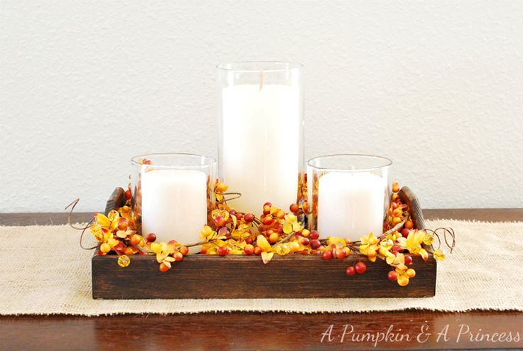 Another great one and I like the yellow ~ I've got sunflowers in my other decor so that would work beautifully.  This blogger stained a wood tray she bought from Hobby Lobby, then arranged it with candles, berries, and a garland. Get the tutorial at A Pumpkin and a Princess. RELATED: 14 Crafts to Get You Ready for Fall   - CountryLiving.com