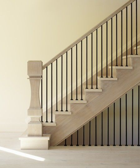an elongated custom newel post feels postmodern seen here in the 2012 showhome order - Home Design Products Anderson In