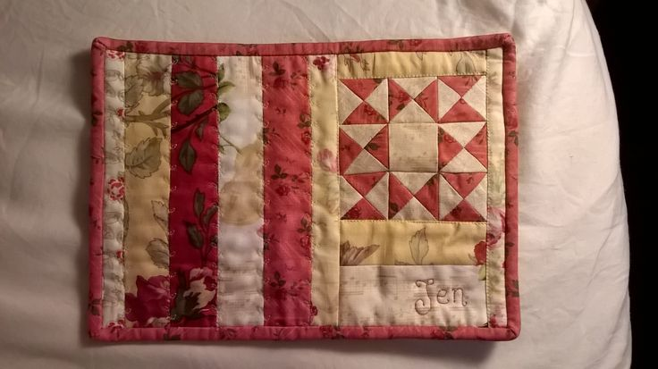 I made this miniature quilted hymn book cover for my sister. I FMQ'd her name on the front.