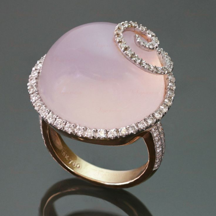 Holy Crap that's pretty in the light.  Cabochon Pink Quart Diamond Gold Cocktail Ring