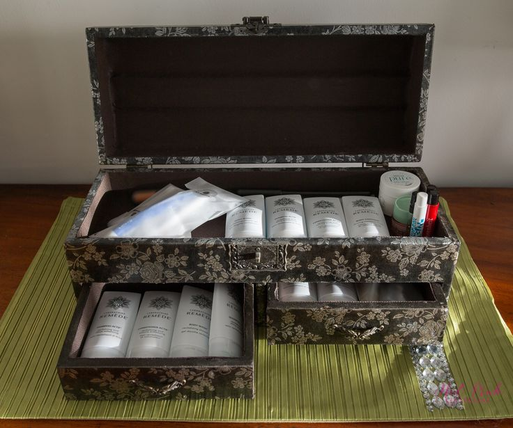 A leather, brown and silver Asian trinket box on the chest of drawers, keeps a variety of toiletries, in case, a guest has forgotten anything.  Shampoo, Conditioner, Bodywash, Face Cream, Razor and Shaving Cream, Toothbrush and Toothpaste and Perfumes are some of items available for guests to use.  Sourced from - What Nots