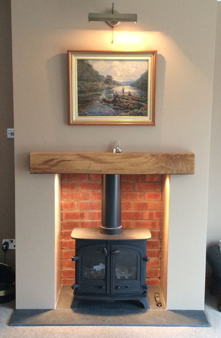 cp wood burning stoves yeoman exe with lighting and brick slip