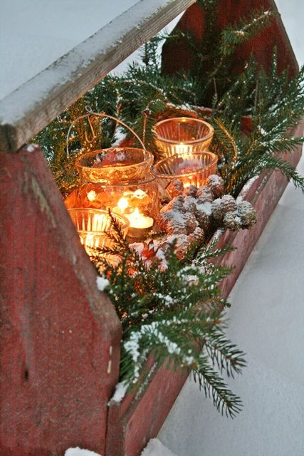 DIY Old Red Tool Carrier...stuffed with holiday greens and old jars with votive candles, makes a really lovely rustic Christmas arrangement.