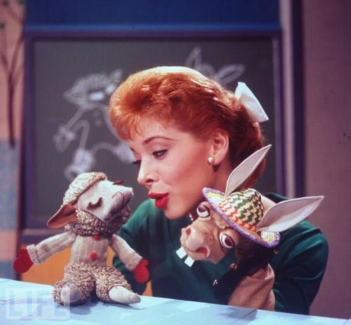 Shari Lewis (1933-1998) was an American ventriloquist, puppeteer, and children's television show host, most popular during the 1960s and 1990s. She was best known as the original puppeteer of Lamb Chop.  In 1952, Lewis and her puppetry won first prize on the CBS television series Arthur Godfrey's Talent Scouts. Lewis then hosted several New York children's series.  NBC gave Lewis her first network program – The Shari Lewis Show (replacing The Howdy Doody Show), which ran 1960-1963.