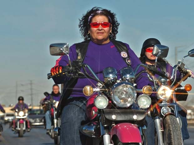 Some brave women.  Pink bikers fight Mexican drug war by helping poor.