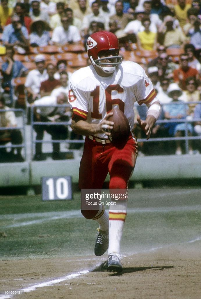 Quarterback Len Dawson #16 of the Kansas City Chiefs rolls out to pass against the San Diego Chargers 1970