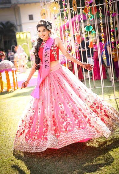 Mehendi Outfits - Pink and Red Lehenga with Threadwork on the Lehenga | WedMeGood  #wedmegood #indianwedding #indianlehenga #indianbride #lehenga #pink #red