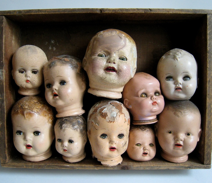 Various Vintage Creepy Doll Heads