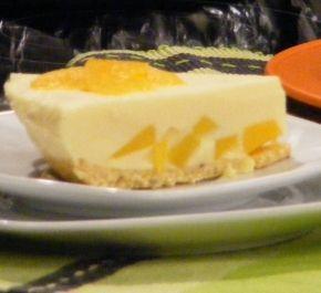 Tarta de yogurt y duraznos con base de amaranto. Peaches and yogurt pie, with amaranth crust.