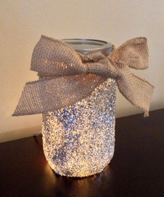 This is for 2 Glitter Lighted Mason Jars! Comes with a drilled hole, and safety stopper for protection from edges. Includes lights that plug into a regular outlet and a burlap bow! Covered with glitter, shown in silver, but we can make any color combo you would like! Fastest turn around will be silver or gold. These can be used I kitchens, bedrooms, bathrooms, or even a bedroom for a night light! Please allow us time to produce the mason jar light. Please also let us know what date you…