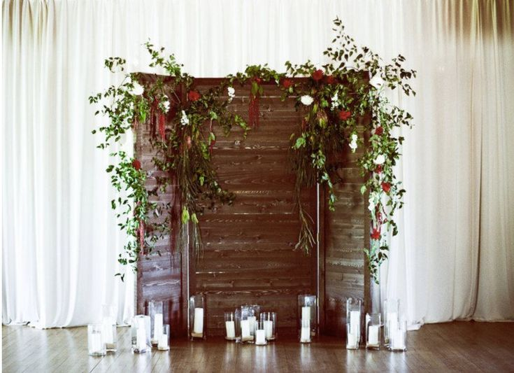 Rustic wedding ceremony backdrop - wooden backdrop with greenery and candles  {Pearl Events Austin}