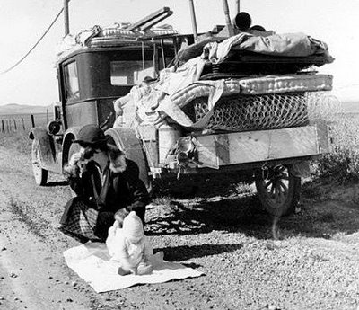 1930s dustbowl - mattresses piled high on the back of a truck