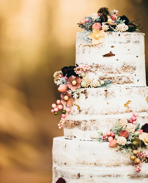From Skys the Limit! in North Carolina, this cake is the definition of shabby chic beautiful with its barely-there icing and delicately placed buds. #InStyle