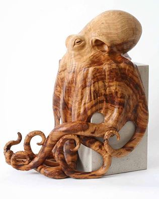 This octopus sculpture is hand carved from a single piece of sweet chestnut…