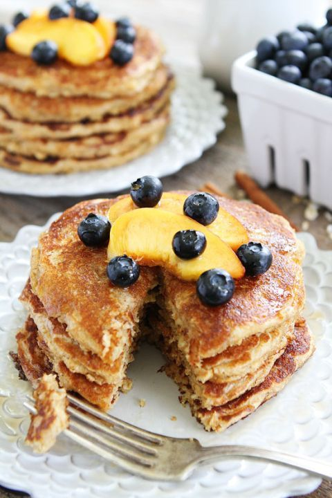 Cinnamon Oatmeal Pancakes Recipe on http://twopeasandtheirpod.com These healthy and hearty pancakes are perfection! Enjoy them for breakfast or dinner!