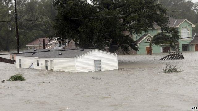 Isaac breaks levee near sodden New Orleans