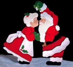 Christmas Kiss under the Mistletoe with Santa and the Mrs. Wood Yard Art.