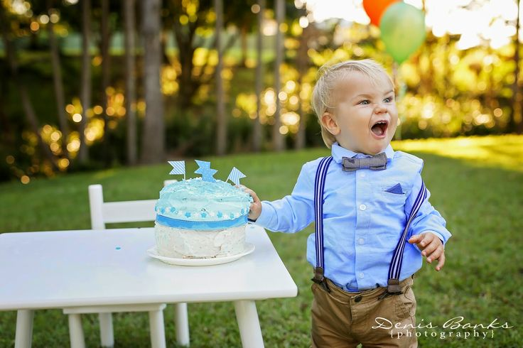 This handsome little man had a great time smashing his cake& check out those blue eyes... What a little spunk!