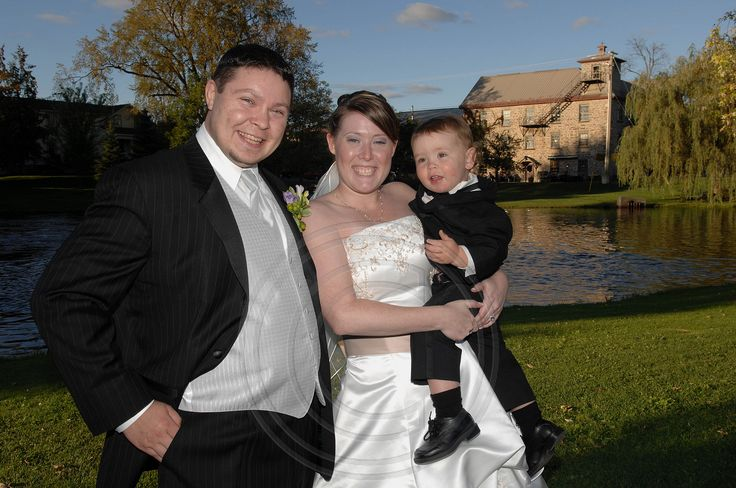 Bride and Groom pose with their nephew at Code's Mill On The Park in Perth, Ontario