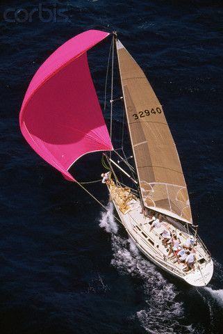 Aerial View of Yacht with Pink Spinnaker  by © Neil Rabinowitz via corbisimages.com