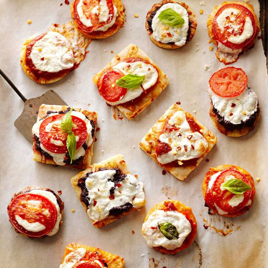 Mini Margherita Pizzas (Healthy Game Day Snacks)..opped with fresh mozzarella cheese and juicy roma tomatoes, these irresistible pizzas will be gone before kickoff! Plus, at only 85 calories, these mini bites make a guilt-free snack.  **4.5 Star Rating.