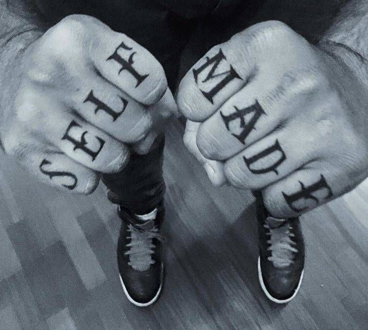 """Self Made"" knuckle tattoo."