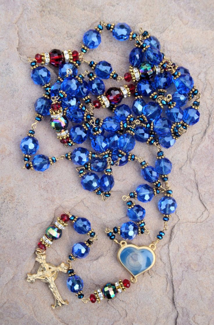 Handmade rosary sky Blue Crystal beads with a heart center the center has holy water from the holy shine of Lourdes France by OurLadysGift on Etsy