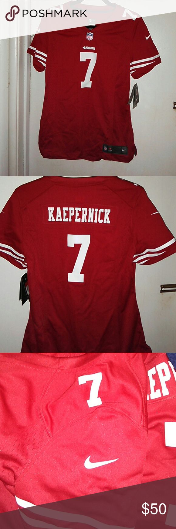 49ers Womens Fitted Nike Jersey NWT This is a very well made jersey, purchased from Fan fanatics..I paid 130 for this but I need to downsize my collection.. Armpit to Armpit is 19, Armpit to bottom is 15, I ship same day or following unless it's holiday Nike Tops