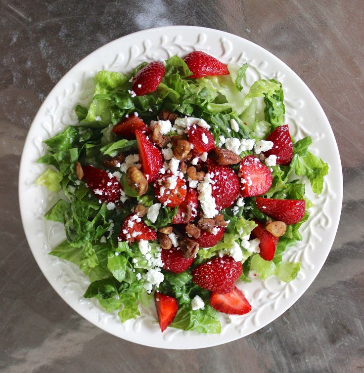 Strawberry salad with poppyseed dressing, pecans, feta, and poppyseed dressing