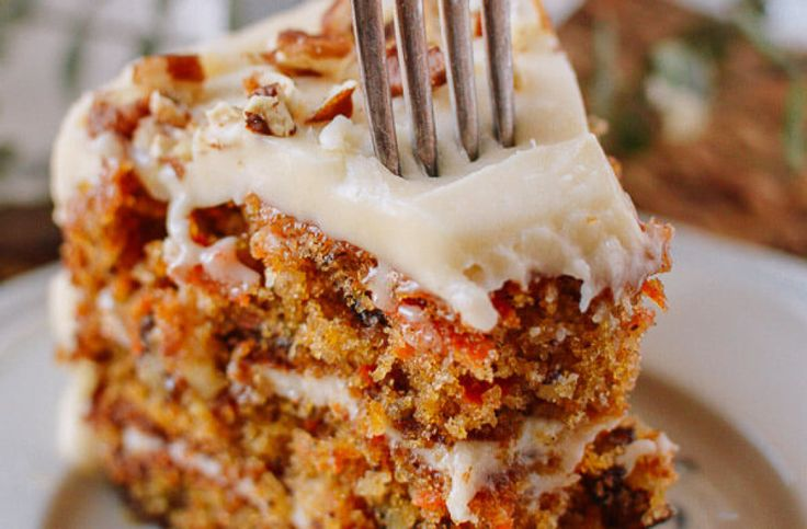 This recipe is chock full of tasty noms (nuts, coconut, and pineapple), moist, and has perfectly thick cream cheese frosting
