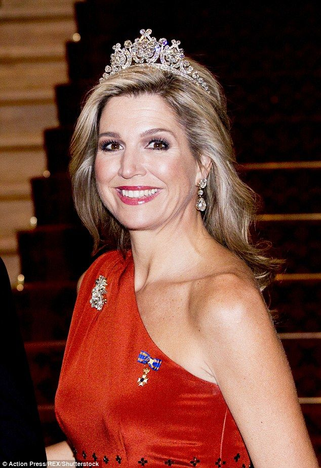 Belle of the ball: Queen Maxima, 45, stunned in a floor-length red gown at a state banquet at Government House in New Zealand
