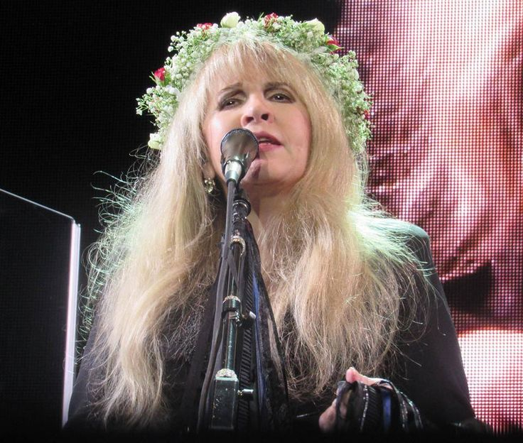 Stevie onstage   ~ ☆♥❤♥☆ ~  singing and; wearing a crown of fresh flowers that a fan gave her ~  photo taken during her '24 Karat Gold' US tour concert 2016  ~  https://www.stevienicksofficial.com/news/stevie-nicks-announces-27-city-north-american-24-karat-gold-tour-with-pretenders