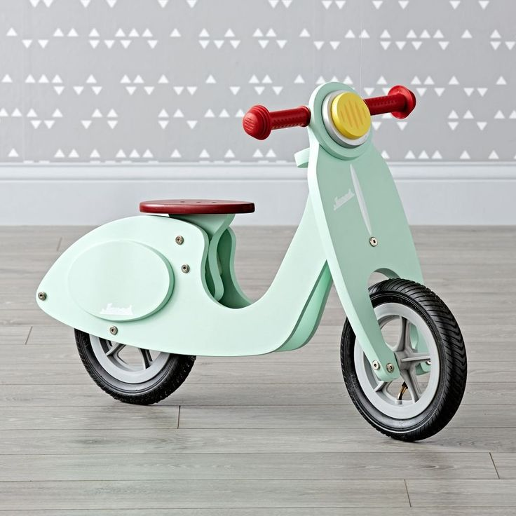 Shop Janod Mint Scooter.  Ideal for use on outdoor trips, this smart retro-style working wooden balance bike scooter helps toddlers develop their balance and coordination.
