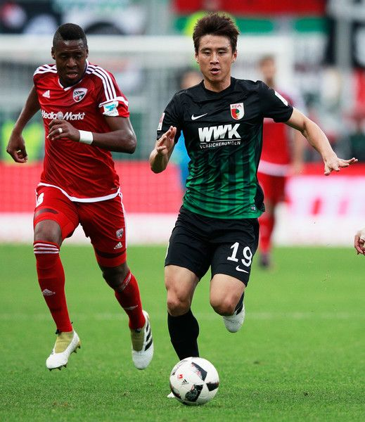 Koo Ja-Cheol of Augsburg in action during the Bundesliga match between FC Ingolstadt 04 and FC Augsburg at Audi Sportpark on November 5, 2016 in Ingolstadt, Germany.