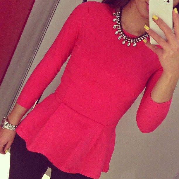 peplum top and big necklace