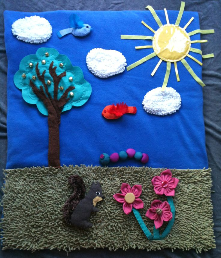 Suzanne at the pie mummy blog made this adorable Baby Sensory Play Mat using my fabric flower tutorials!  How clever!