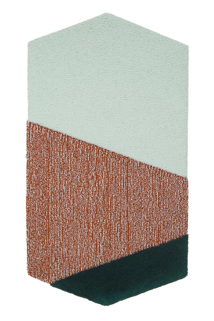These rugs are handcrafted in Italy from New Zealand wool with bright, graphic patterns. Made by Portego