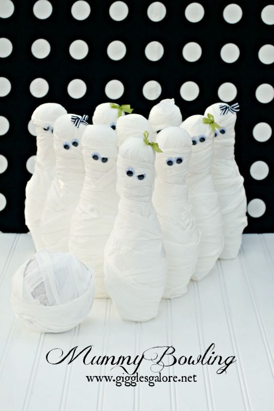 Mummy Bowling Halloween Party Game.  Wrap bowling pins and a ball in toilet paper for an easy and fun Halloween game the kids will have a blast playing.
