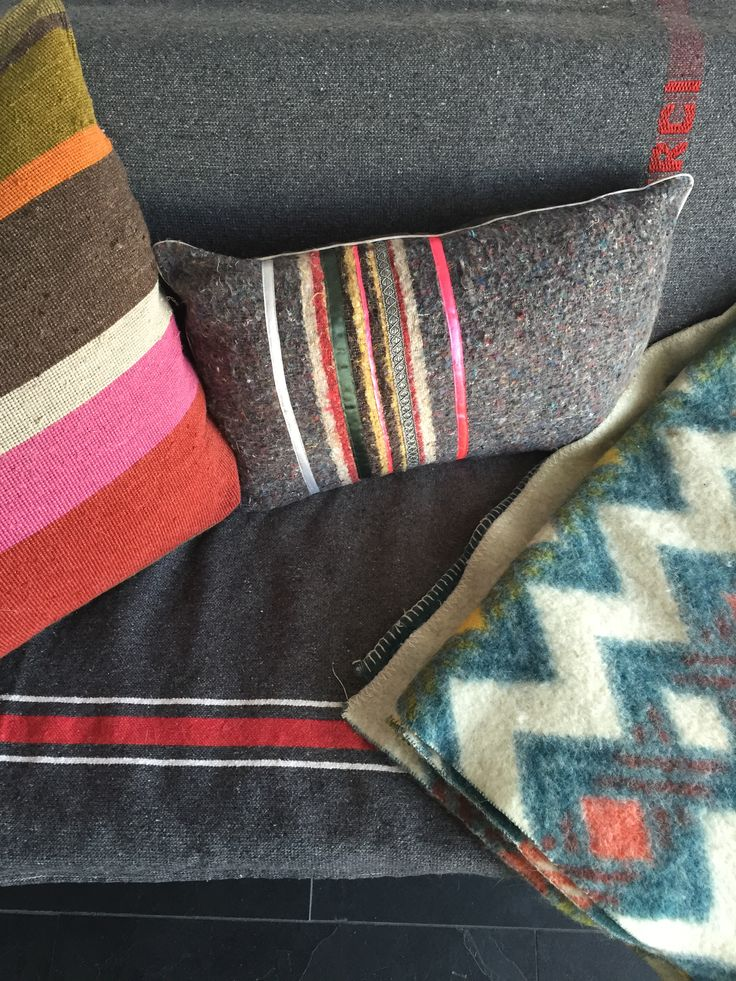 Materials on a #MartinVisser sofa with #Merci plaid and #ladakh pillow.