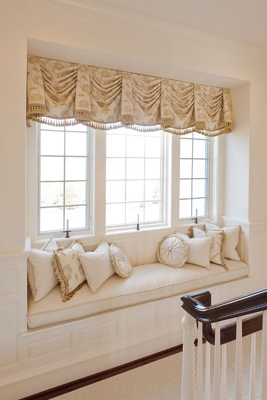 Window treatment for a window seat.  There's one option. Skip the curtains. But lord how are you supposed to sit down with all those pillows about?