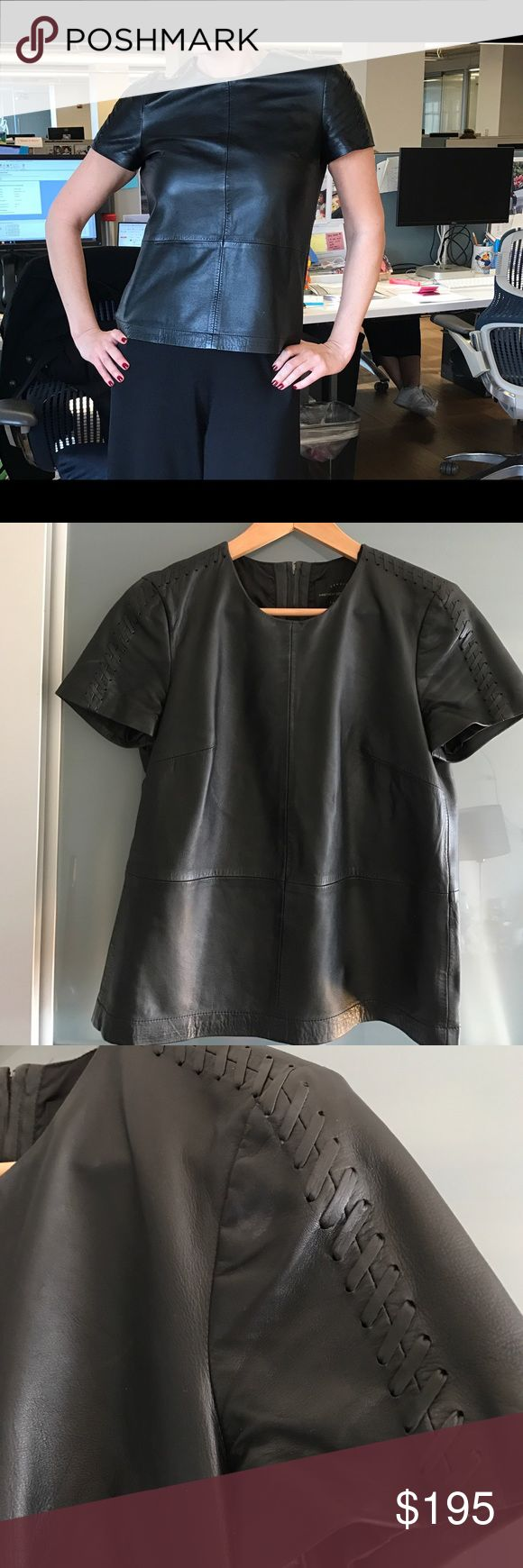 """Genuine leather TShirt with leather shoulder seam Genuine 100% leather TShirt with beautiful leather shoulder seam. Measures 15"""" in the shoulders, 21"""" in length. With lining (100% polyester).  Zipper in the back, 6.5"""" from neck. French Connection Tops"""